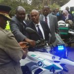 Inspector General Joseph Boinnet, NTSA Director General Francis Meja and Public Works PS Prof. Paul Maringa checking a motorcycle handed over by NTSA