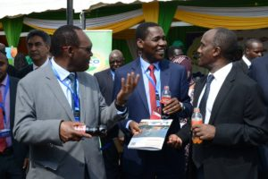 Trade CS Peter Munya sampling a product at the Trade Week show