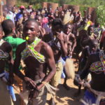 Initiates at the ground during the circumcision ceremony