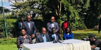 Migori Governor Okoth Obado, flanked by his family members, addressing the press