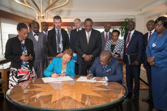 President Kenyatta witnessed the signing of a deal to deliver 100,000 affordable housing units to Kenyans between UNOPS and the Kenyan government. (PHOTO/PSCU)