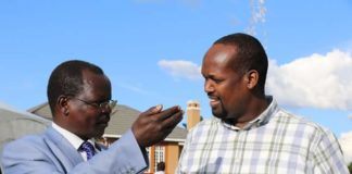 West Pokot Governor John Lonyangapuo (left) talking FCDC chairman and Mandera Governor Ali Roba (right)