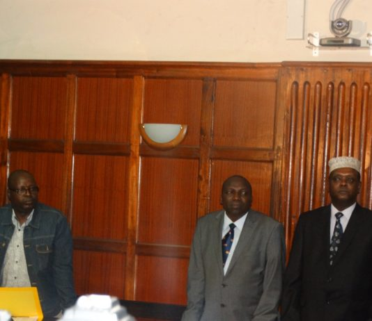 Former Sports CS Hassan Wario (right) and other officials in court