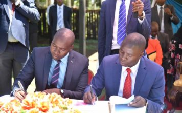 Nandi Governor Stephen Sang (right) signed performance contracts with the County CECs
