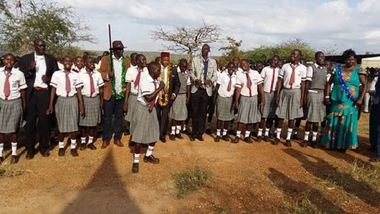 Pokot leaders in a traditional song with students at Emboasis secondary school /Photo/ Leonard Wamalwa /West Fm