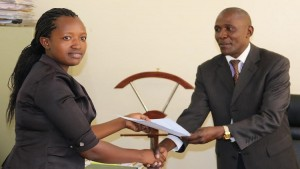 Mr. Laurence Omwaka the Kakamega County human resourse presenting a certificate of appointment to one of the newly appointed nurses/Photo/ Brendah Wawire/West Fm