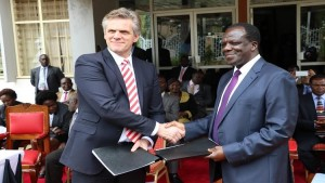 Kakamega County governor Oparanya and Smart Dairy director Peter Paul exchange a MOU after signing it /Photo/ Wawire Brendah/ West Fm