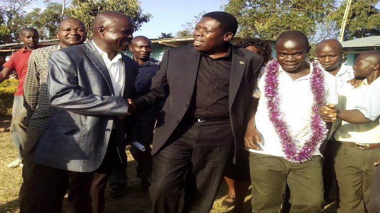 The water cabinet secretary Eugine Wamalwa being welcomed by the Webuye location chief Misiko Barasa and Matulo ward MCA Paul Wanyama at Webuye DEB primary /Photo/ Sasakah/West Fm