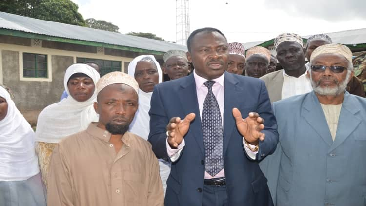 County commissioner Wilson Wanyanga with Muslims leaders during handing over of food  donation from the national government in Kapenguria