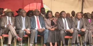 Leaders following proceedings at the memorial service