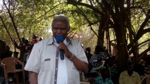 Catholic Bishop Cornelius Korir addressing residents during the peace meeting