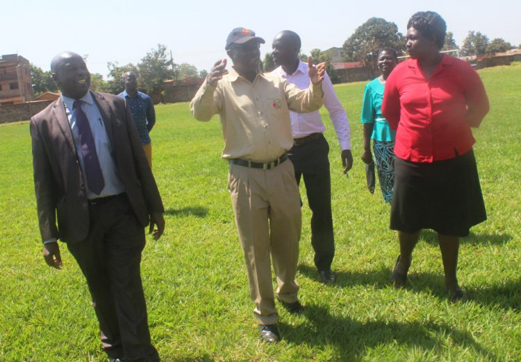CEC for Sports Martin Kafwa, CRA CEO George Ooko and Sports Officer Margaret Oduma tour the Busia County Stadium