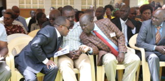 Trans Nzoia Governor Patrick Khaemba consults with Kiminini MP Chris Wamalwa during a past function