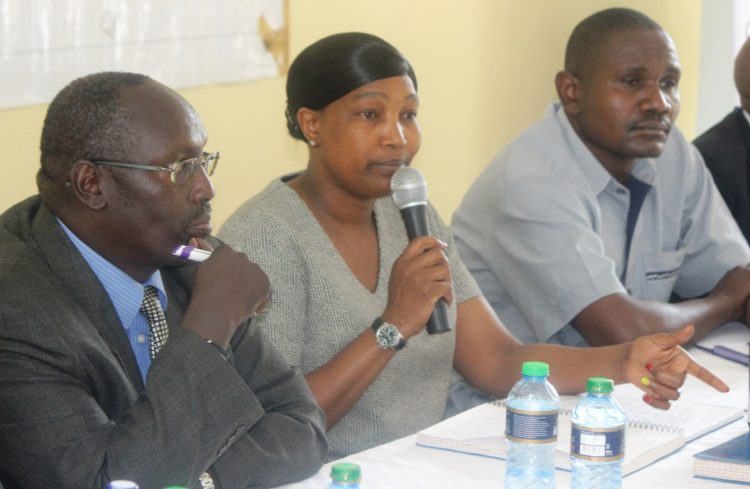 Committee members Rev. David Sawe, Regina Boisabi, and Assistant County Commissioner Mr. Oloo in Busia