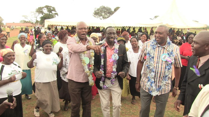 Saboti MP David Wafula Lazaro leading his colleagues to a dance during the ceremony in Kitale