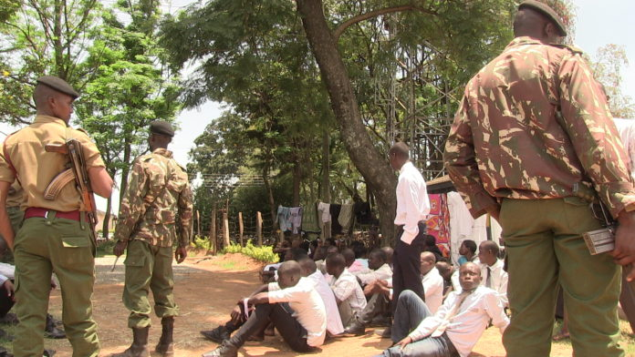 Security personnel taking vigil at the police station as details of the arrested youth were being taken