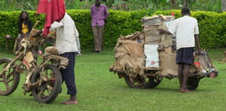 The wooden Tuk Tuk and motorcycle that were crafted and made by Andrew Muchilwa