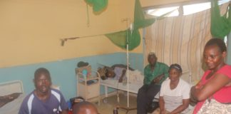 Patients ponder what to do at theBusia County Referral Hospital with no nurses in sight