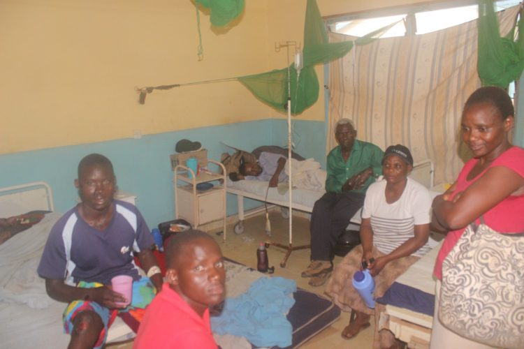 Patients ponder what to do at the Busia County Referral Hospital with no nurses in sight
