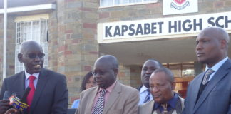 Principal Secretary Belio Kipsang (L) addressing the press at Kapsabet High School