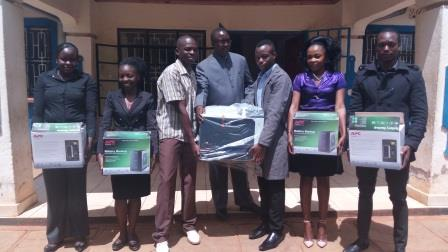 ICT Officer Tony Otieno with other officers when they handed over the computers to the county government