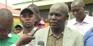 Kwanza Sub County chairman for the Ford Kenya party Peter Puuka at the Ford Kenya buildings addressing the press