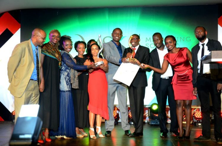 ICT Authority CEO Robert Mugo (middle with grey suit) and PMS Group MD Joanna Gow next to him receive the Best Distribution Strategy and the Judges Category Award for the Digital Literacy Programme Launch