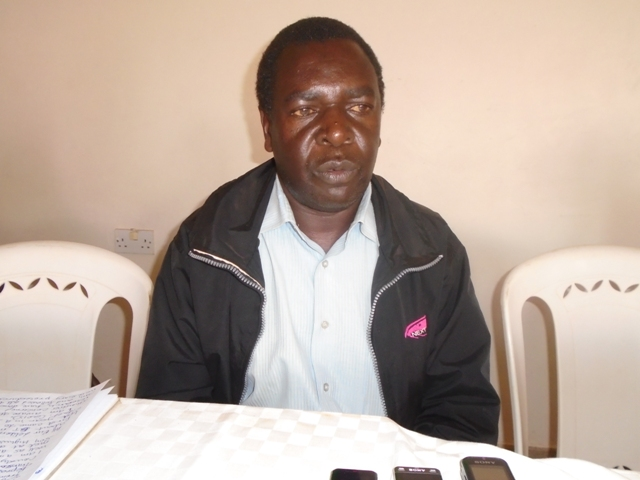 Mr Nahashon Ongole a maize farmer who is a member of the CGA addressing the press in Likuyani Sub County