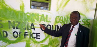 Mr Stephen Ndiema, a member of the Amani National Congress (ANC) party, displaying the scribbled paint on the party's logo