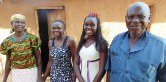 Sisters Everlyne Asande (second left) and Faith Nafula with their parents at their Machakusi village home