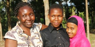 Brenda Atieno (centre), her mother and young sister. The former Isegere TotoAcademy pupilin Teso North has been admitted at LoretoHigh School Limuru