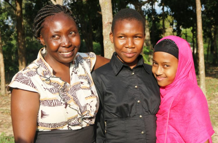 Brenda Atieno (centre), her mother and young sister. The former Isegere Toto Academy pupil in Teso North has been admitted at Loreto High School Limuru