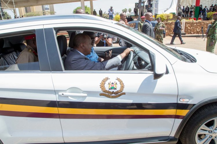 President Uhuru Kenyatta during the unveiling of police vehicles in Nairobi