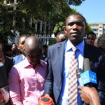 KMPDU Secretary General Ouma Oluga (centre) addressing the press in a past function