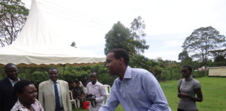 Emgwen MP Alex Kosgey giving out the project cheques to primary school headteachers
