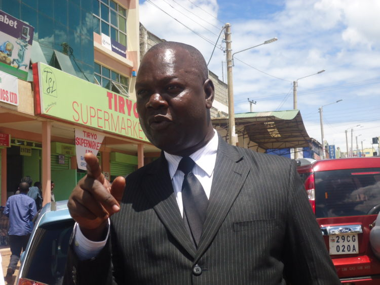 Director of Youth and Gender Affairs for Nandi County Alex Otieno Oyuga addressing journalists in Kapsabet town