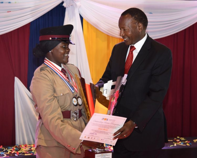 Interior CS Joseph Nkaissery awarding a police officer during the ceremony in Nairobi