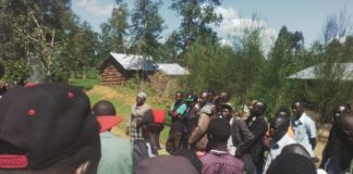 Lumino village residents at the scene of the incident where the suspected thief was lynched
