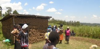 Relatives and neighbours at the deceased's home