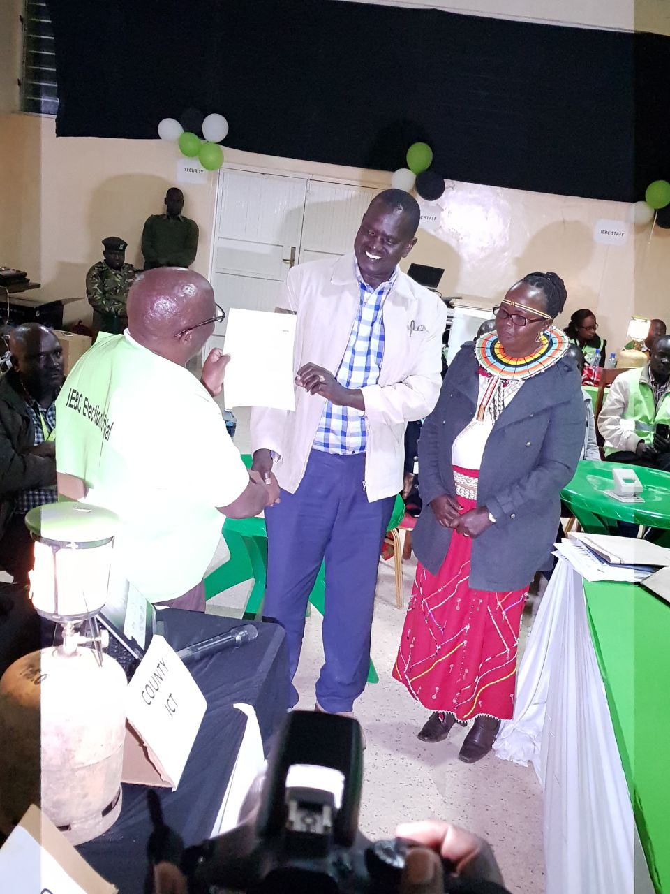 Senator Elect Samuel Poghisio receive his certificate joined by his wife