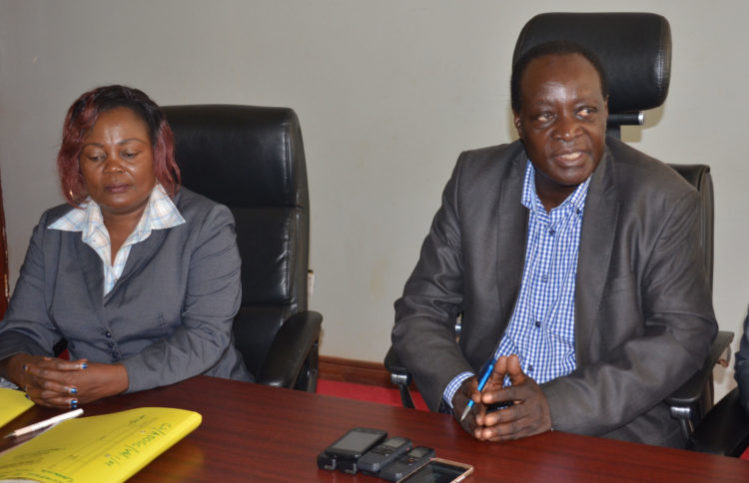 Vihiga Governor Wilber Otichilo (right) said it's prudent for charged Governors to step aside