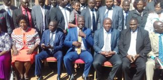 Trans Nzoia Governor Patrick Khaemba (centre) has called upon leaders to work together to develop the County