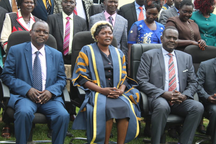 West Pokot County assembly speaker Catherine Chepkemoi Mukenyang (centre) flanked by Governor John Lonyangapuo (left) and Senator Samuel Poghisio (right)