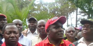 Deberious Shikuku Wafula (R) speaking to press after his defection to Jubilee
