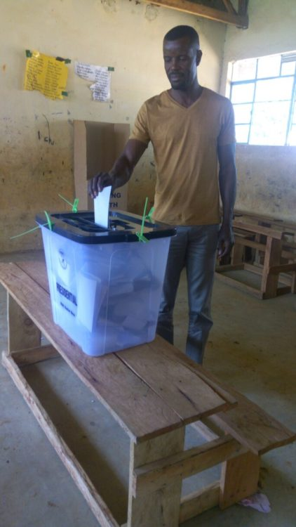 Webuye West MP Dan Wanyama casting his vote in Chebosi S.A Primary school