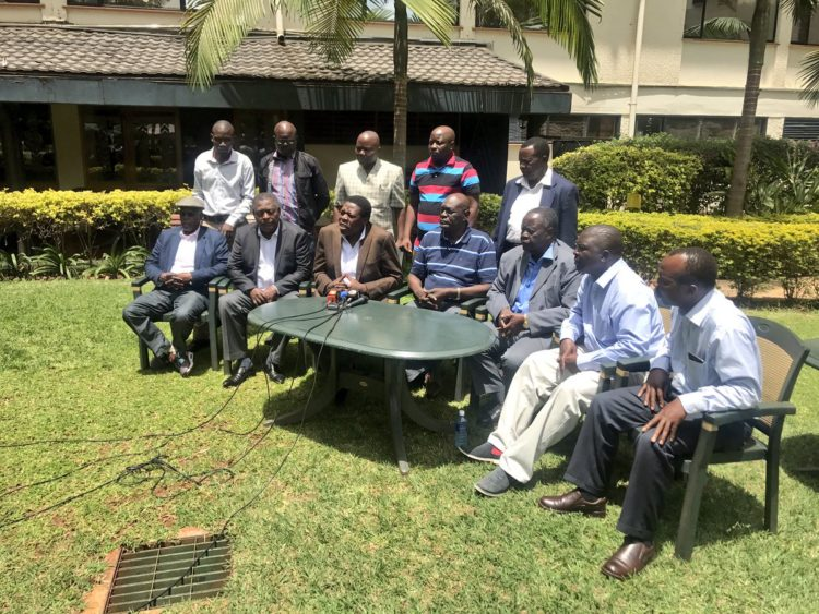 Water CS Eugene Wamalwa (Third left) addressing the press, together with the delegation from the Luhya community