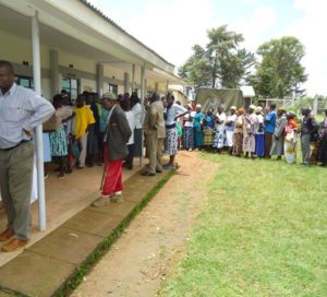 A long queue of residents who turned up to collect mosquito nets in Lugari