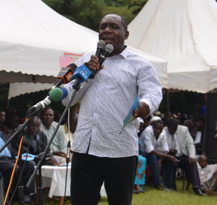 Sabatia MP Alfred Agoi while addressing parents at Mululu Primary School