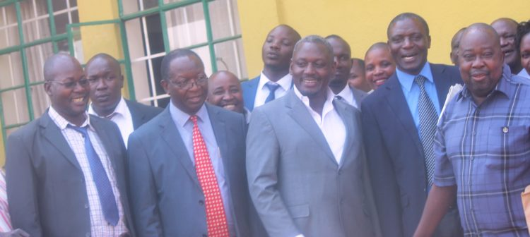 Busia Governor Sospeter Ojaamong's lawyer Otiende Amollo (centre), Deputy Governor Moses Mulomi on his right and other supporters outside the Busia High Court on Tuesday
