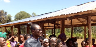 Kimilili MP Didmus Barasa (centre) has pledged to phase out grass thatched houses to help residents
